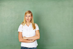 Woman as teacher in front Stock Photography