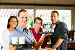 Woman as waitress in a bar or restaurant Royalty Free Stock Image