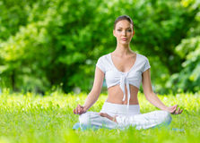 Woman in asana position zen gesturing Stock Images