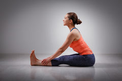 Woman in Ashtanga Vinyasa yoga back bending asana Royalty Free Stock Photo
