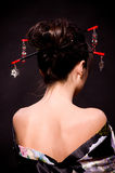Woman in Asian costume on black background. Royalty Free Stock Image