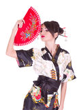 Woman in Asian costume with red Asian fan Stock Images