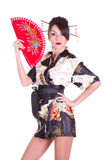 Woman in Asian costume with red Asian fan Royalty Free Stock Photography