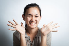 Woman asian smiling with  open palms. Royalty Free Stock Image