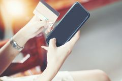 Woman asian using phone and credit card shopping online , select royalty free stock photo