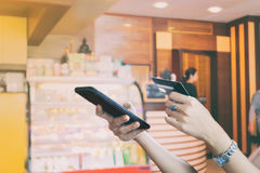 Woman asian using smart phone and credit card shopping online ,. Selective focus on hand Stock Photos