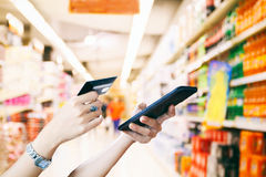 Woman asian using smart phone and credit card shopping online ,. Selective focus on hand Royalty Free Stock Photo