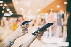 Woman asian using smart phone and credit card shopping online ,. Selective focus on hand Royalty Free Stock Photography