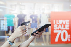 Woman asian using smart phone and credit card shopping online ,. Selective focus on hand Stock Images