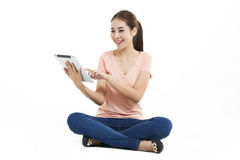 Woman. Asian young woman use of the tablet Stock Images
