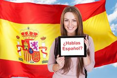 Woman asking do you speak spanish. Young Woman Holding Digital Tablet Asking Do You Speak Spanish Stock Photos