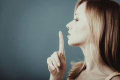 Free Woman Asking For Silence Finger On Lips Stock Photo - 85536270