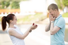 A woman asking her boyfriend to marry Royalty Free Stock Photo