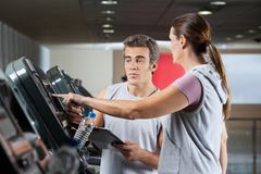 Woman Asking About Machines In Gym Royalty Free Stock Photo