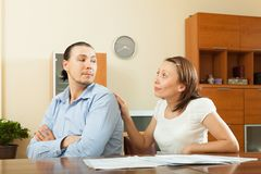 Woman asking for money from  husband Stock Image