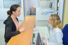 Woman asking patient`s information. Woman asking a patient`s information Stock Photography