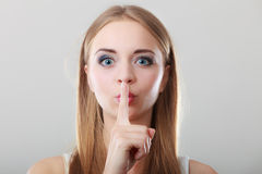 Woman asking for silence finger on lips Royalty Free Stock Images