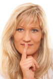 Woman asking for silence finger on lips hush gesture. Royalty Free Stock Photos