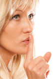 Woman asking for silence finger on lips hush gesture. Stock Photos