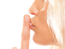 Woman asking for silence finger on lips hush gesture. Woman asking for silence or secrecy with finger on lips hush hand gesture. Isolated Stock Photography