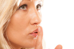 Woman asking for silence finger on lips hush gesture. Royalty Free Stock Photography