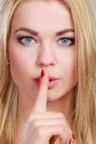 Woman asking for silence finger on lips hush hand gesture. Royalty Free Stock Image