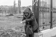 The woman asks for alms. Tiraspol, the unrecognized republic of Transnistria. Black and white photo Royalty Free Stock Images