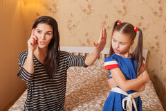 Woman asks the child to be silent Royalty Free Stock Image