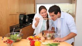 Woman asks her boyfriend to taste her sauce stock footage