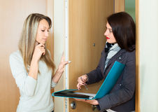 Woman asks questions hostess Royalty Free Stock Photography