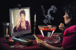 Woman asks to online psychic for hand prediction Stock Photos