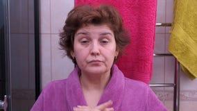Woman asleep in bathroom in morning. Early morning