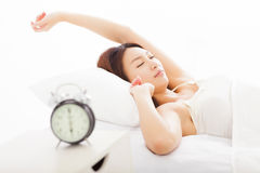 Woman asleep in the bed. Young woman asleep in the bed Royalty Free Stock Images