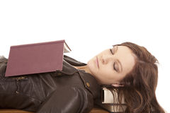 Woman asleep book on chest Royalty Free Stock Images