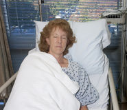 Woman asleep in hospital Stock Photography