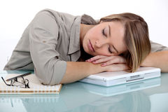 Woman asleep on laptop Royalty Free Stock Image