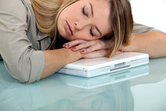 Woman asleep on laptop Royalty Free Stock Photography