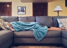 Woman asleep on the sofa