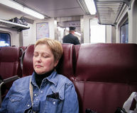 Woman asleep on train Royalty Free Stock Photos
