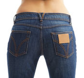 Woman in jeans. Closeup of female buttocks in blue jeans isolated over white background royalty free stock photos