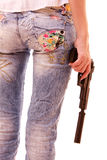 Woman ass and pistol in hands isolated Royalty Free Stock Image