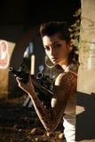 Woman with assault gun Stock Photography