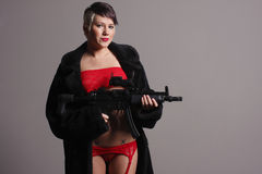 Woman with assault rifle Stock Photos