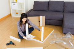 Woman assembling  furniture Royalty Free Stock Photos