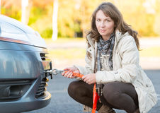 Woman assembling towing hook Royalty Free Stock Photos