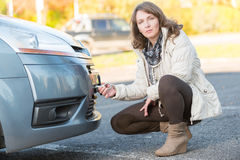 Woman assembling towing hook Royalty Free Stock Image