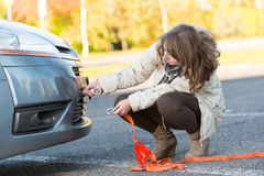 Woman assembling towing hook Stock Photography