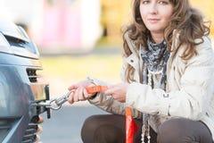 Woman assembling towing hook Royalty Free Stock Photo