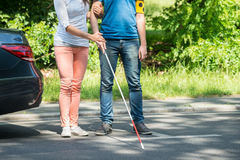 Woman Assisting Blind Man On Street stock images