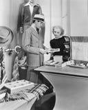 Woman assisting male customer Stock Photo